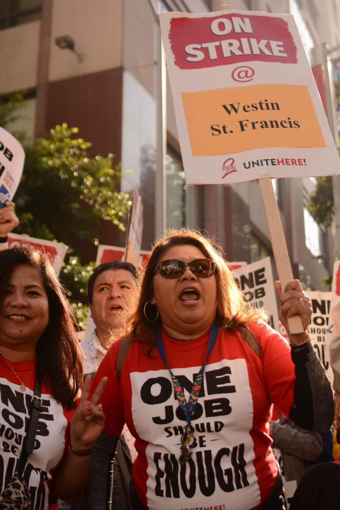 Karla Ayala (right), 45, a five-year server at the Westin St. Francis hotel, demonstrates to demand better working conditions and to keep her benefits in San Francisco, Calif., on Saturday, Oct. 20, 2018. (Aaron Levy-Wolins/Golden Gate Xpress)