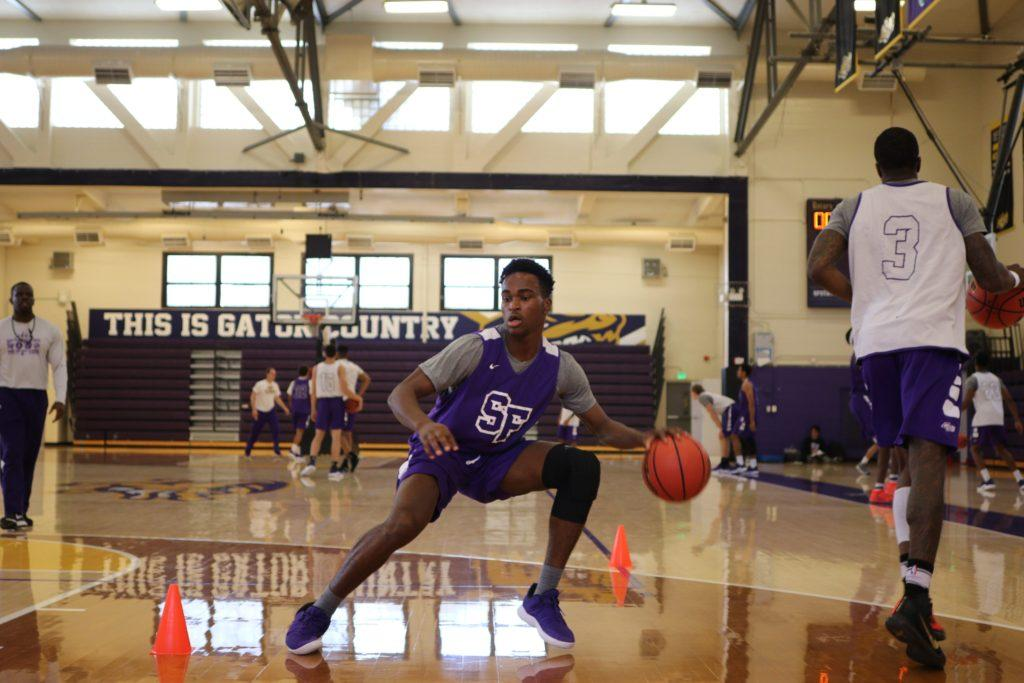 Jeff Okeke, 24, forward, runs a drill in the gym at SF State on Monday October 22, 2018. © (Oscar Rendon/GoldenGateXpress)
