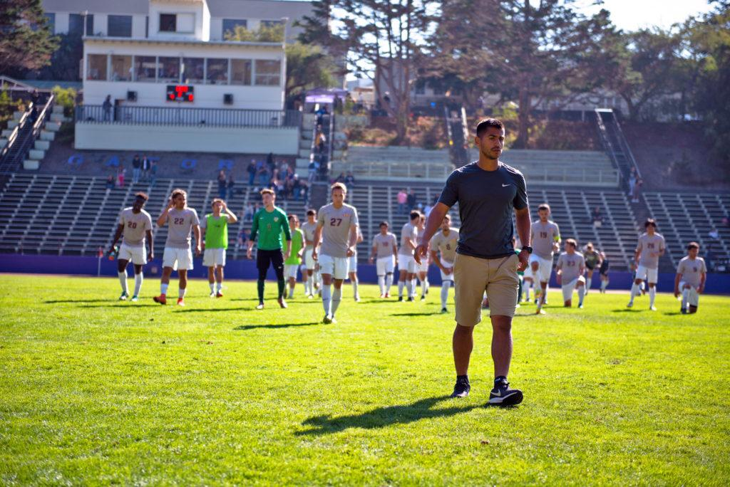 The men's soccer team ends the game with a few stretches after they secured a 4-0 win against the Stanislaus State Warriors on Friday, Oct. 19. (David Rodriguez/Golden Gate Xpress)