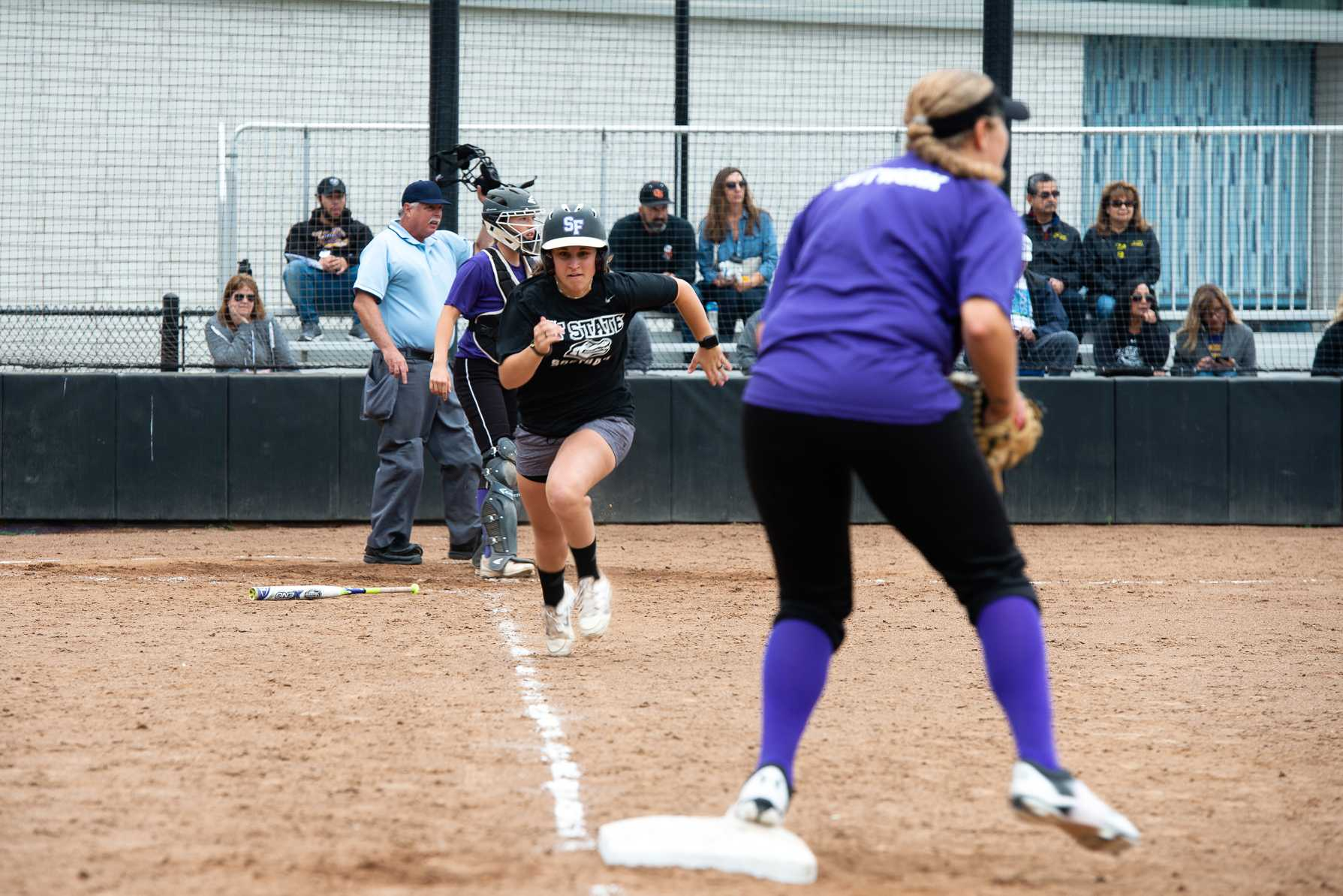 SF State alumna Jennifer Lewis runs to first base during the annual softball alumni game at the Softball Field on Saturday, Oct. 13. (David Rodriguez/Golden Gate Xpress)