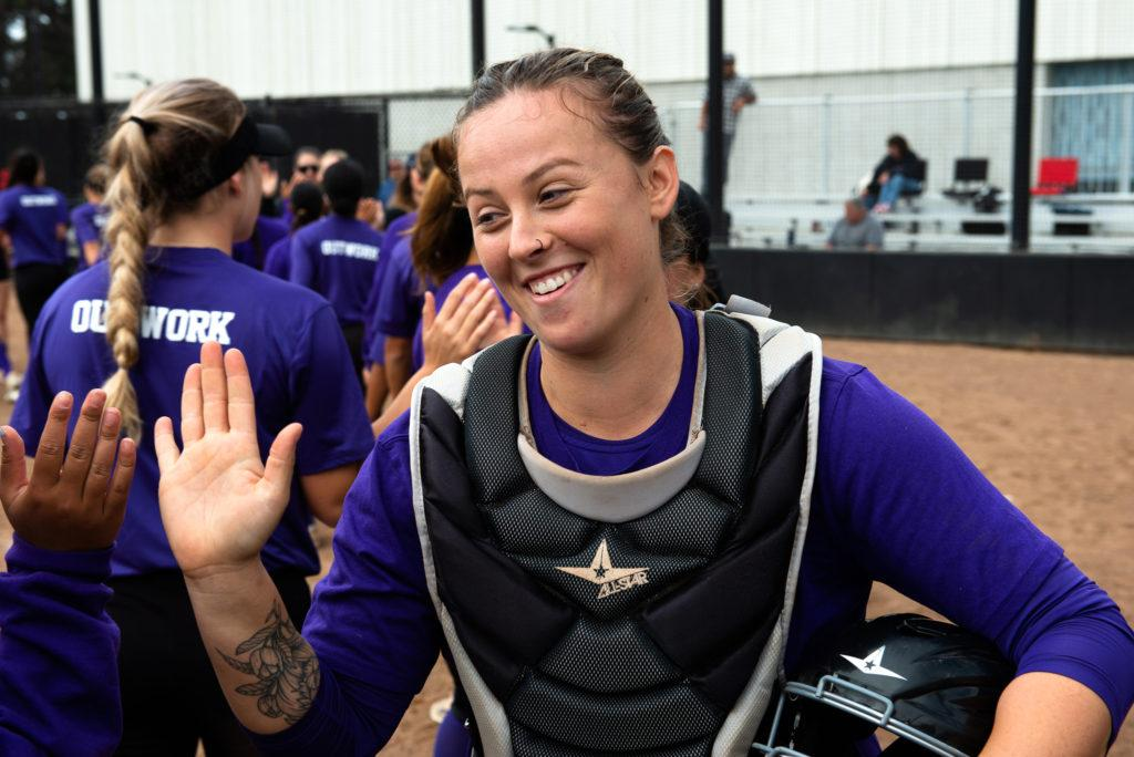 Angelica Terrel, smiles as she and her alumni team take the win at the annual alumni game at the Softball Field on Saturday, Oct. 13, 2018. (David Rodriguez/Golden Gate Xpress)