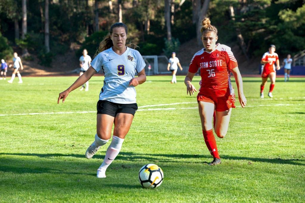 Gators forward Marriah Perez (9), fights for the ball against Stanislaus State player Autumn Halvorsen during the SF State's women's Soccer game against the Stanislaus State Warriors on Friday, Oct. 19, 2018. (David Rodriguez/Golden Gate Xpress)
