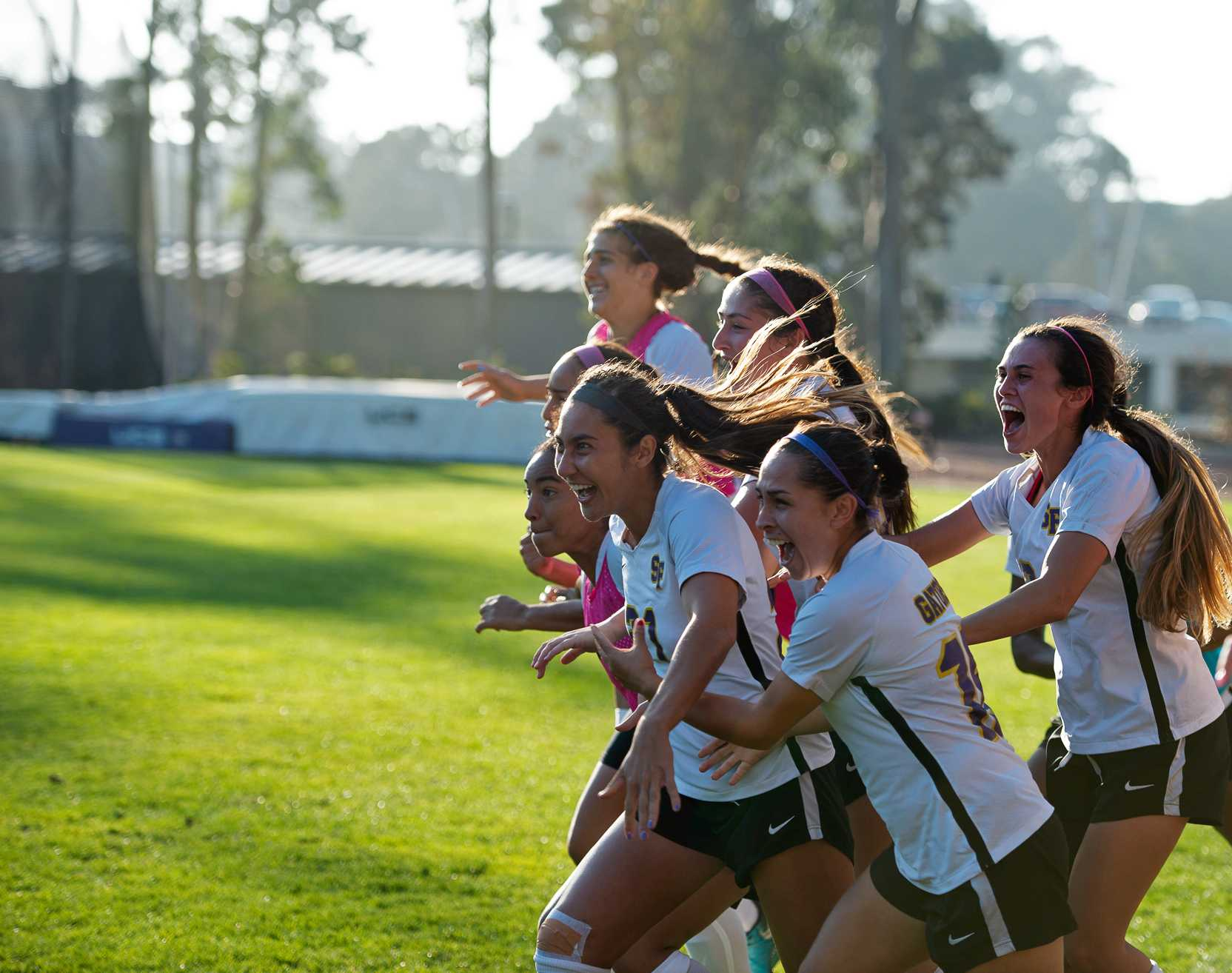 The SF State women's soccer team celebrates, as the team secure the 1-0 victory against the Stanislaus State Warriors on Friday, Oct. 19. (David Rodriguez/Golden Gate Xpress)