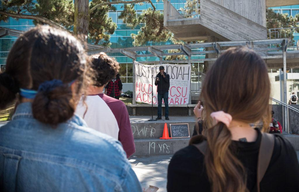 SF State Africana studies and BECA major, Damion Square (center), 28, speaks at the protest for the murder of Humboldt State student, David Josiah Lawson, on Monday, Oct. 15, 2018.
