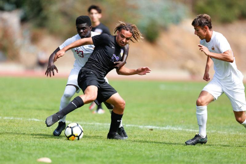 SF State midfielder Brandon Brunac (center) competes for a loose ball against two CSU Dominguez Hills defenders during the Gators dominating win on Sunday, Sept. 30, 2018 (Niko LaBarbera/Golden Gate Xpress)