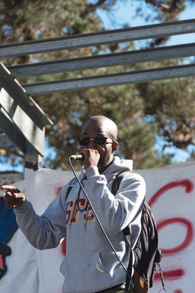 Africana studies and BECA double major Damion Square, 28, speaks during a protest at Malcolm X Plaza on Wednesday, Oct. 24. (Chris Robledo/ Golden Gate Xpress)