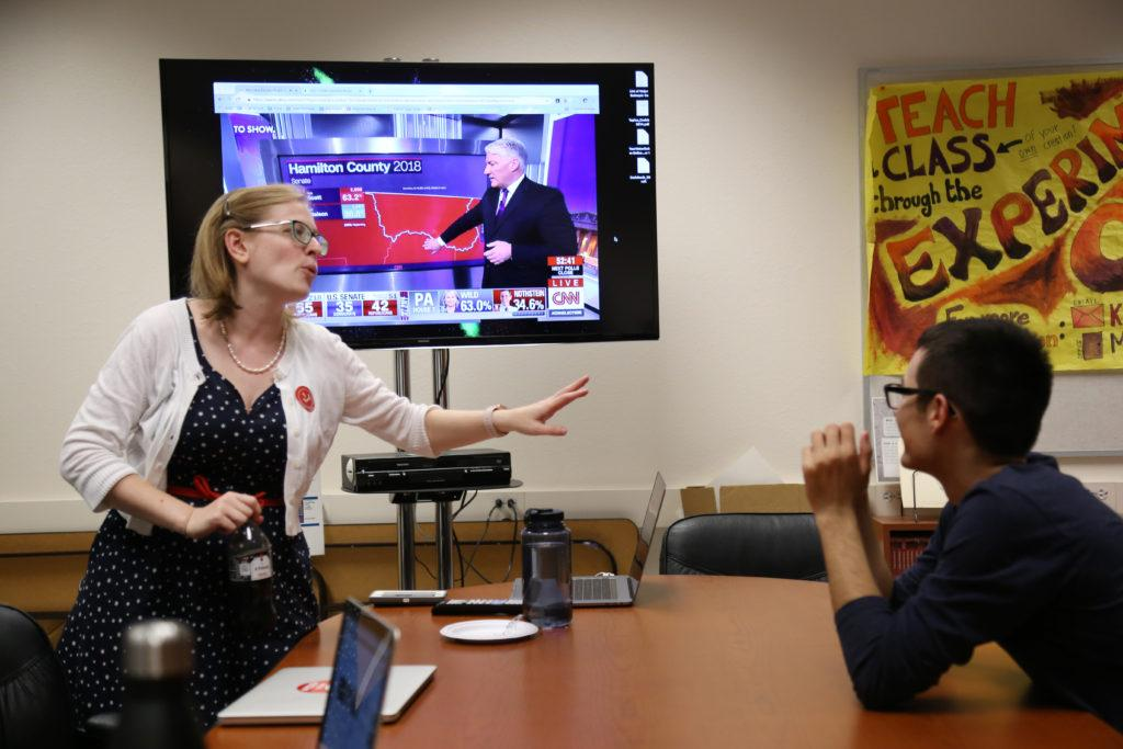 Political science professor Rebecca Eissler speaks to Arthur Carlos during a midterm election watch party hosted by SF State's Political Science Department held in the Humanities Building on Tuesday, Nov. 6, 2018. (Mira Laing/Golden Gate Xpress)