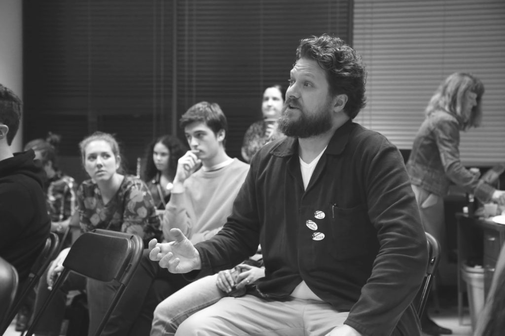 Alexander Otruba contributes to a political discussion during a Midterm Election watch party hosted by SFSU's Political Science department held in the Humanities Building on Tuesday, November 6th, 2018. (Mira Laing/Golden Gate Xpress)