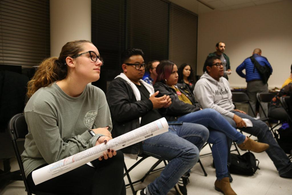 Michaela Byrd listens to political science professors speak during a Midterm Election watch party hosted by SF State's political science department held in the Humanities Building on Tuesday, Nov. 6, 2018. (Mira Laing/Golden Gate Xpress)
