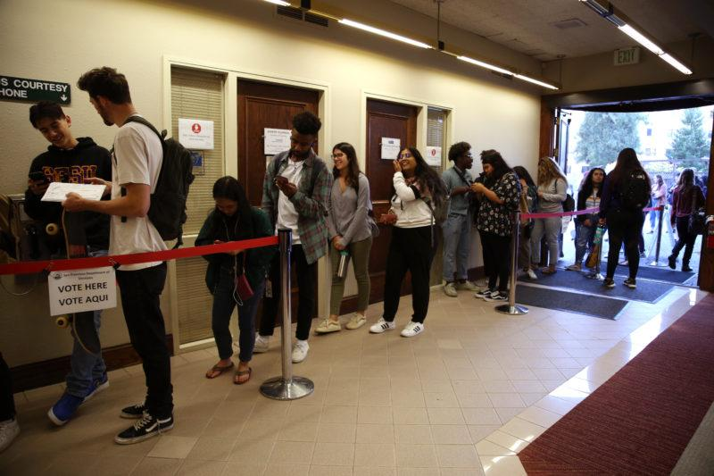 People wait in line at SF State's Seven Hills Conference Center to cast their votes in the Midterm Elections on Tuesday, Nov. 6, 2018. Some students waited in lines for three hours to cast their votes. (Mira Laing/Golden Gate Xpress)