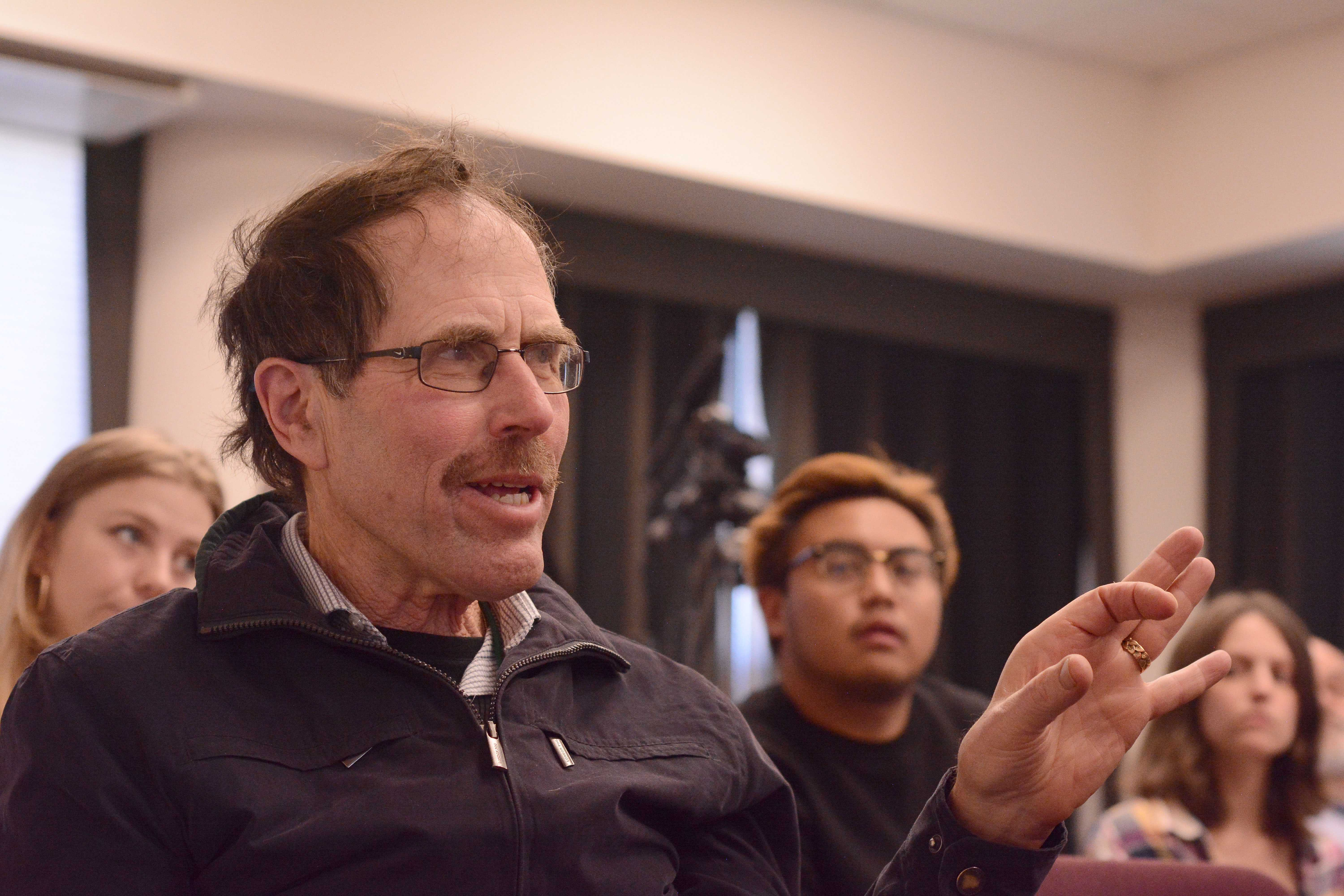 Lee Heidhues, a former journalist on The Gator newspaper and 1969 SFSU alumnus, asks a question to a panel of Xpress editors during the SFSU journalism department's event commemorating the fiftieth anniversary of the 1968 Strike at SF State in San Francisco, Calif. on Wednesday, Nov. 14, 2018. (Aaron Levy-Wolins/Golden Gate Xpress)