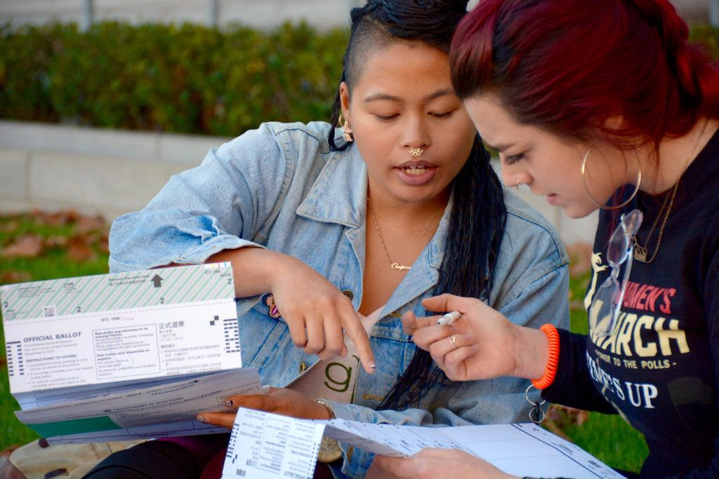 SF State alum Sabrina Sakdikul (left) and current SF State BECA major Amanda Lamb (right) vote outside city hall on Tuesday, Nov. 6, 2018. Sakdikul registered to vote today after moving back to the Bay Area from the Carribean. (Tristen Rowean/Golden Gate Xpress)