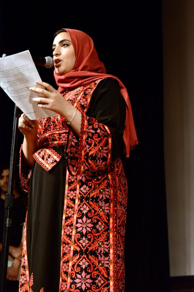 A member of the General Union for Palestinian Students reads a rebuttal to an incident with a racist student at the 11th commemoration of the Edward Said mural at SF State on Thursday, Nov. 1, 2018. (Aaron Levy-Wolins/Golden Gate Xpress)