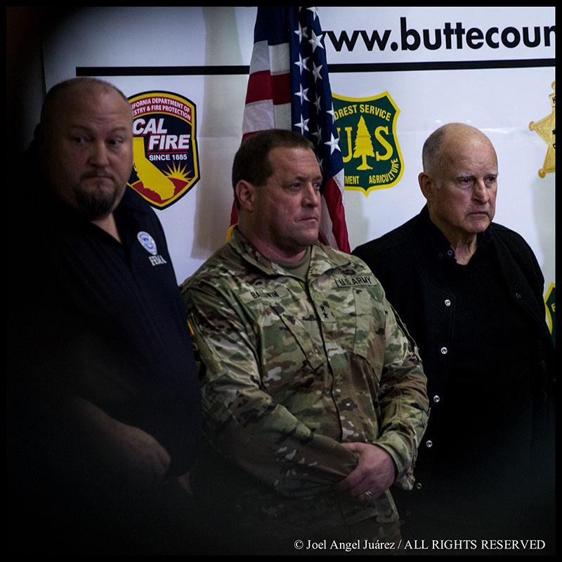 California Gov. Jerry Brown, right, attends a press conference during a visit at the Camp Fire incident base at the Silver Dollar Fairgrounds in Chico, Calif., Wednesday, Nov. 14, 2018. (© 2018 Joel Angel Juárez. All rights reserved.) (Special to Golden Gate Xpress)
