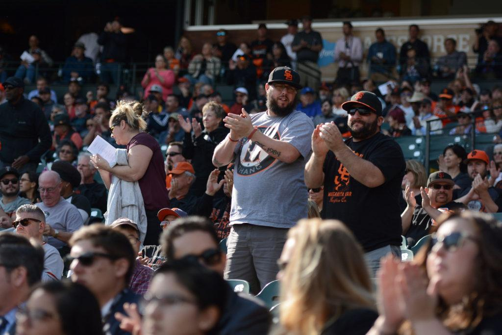 San Francisco Giants fans give a standing ovation to 1989 Willie Mac award winner Dave Dravecky at Willie McCovey's celebration of life at AT&T Park in San Francisco, Calif., on Thursday, Nov. 8, 2018. The former Giants hall of fame slugger,