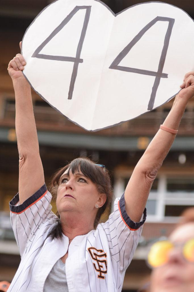 Bernadette Bay, 61, holds a large heart with the number 44, in honor of Willie McCovey's jersey number, at McCovey's celebration of life at AT&T Park in San Francisco, Calif., on Thursday, Nov. 8, 2018. The former Giants hall of fame slugger,