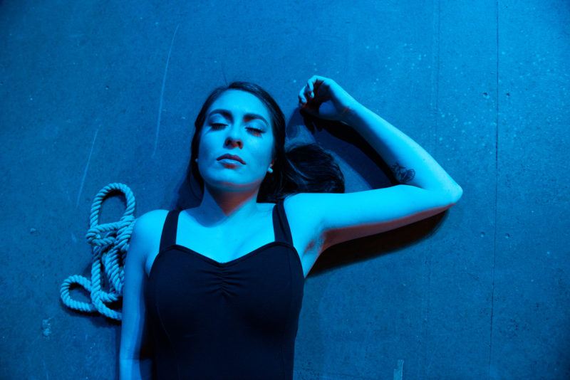 Ensemble member Ariana Rodriguez lays on the stage inside the Little Theater as the opening night of Pericles, Prince of Tyre begins. The play premiered in The School of Theater & Dance on Thursday, Nov. 01, 2018. (David Rodriguez/Golden Gate Xpress)