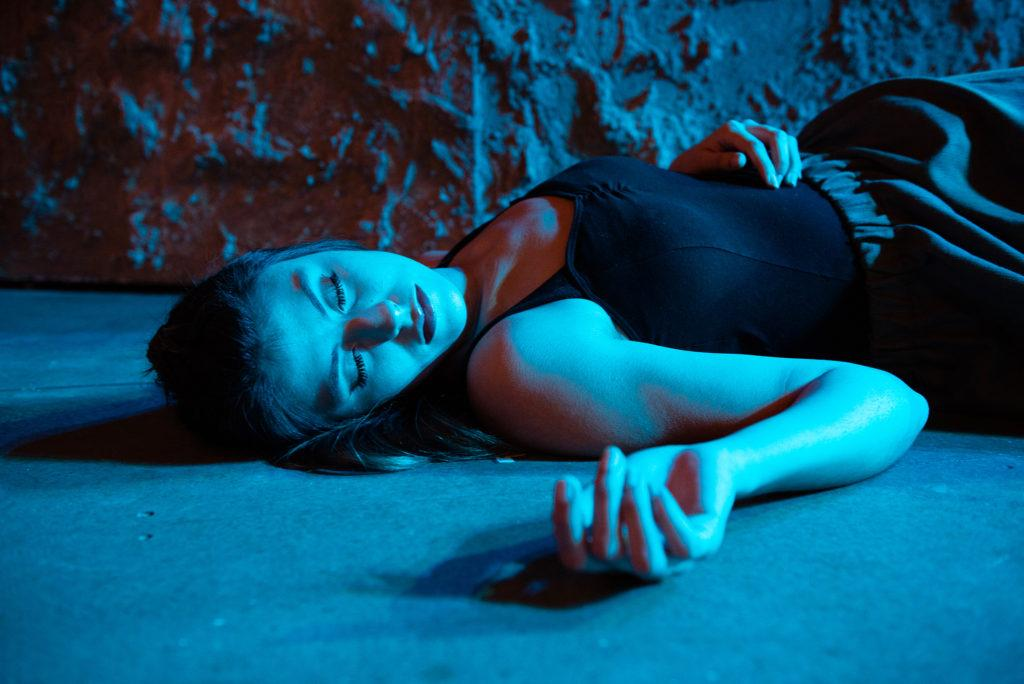 Clarissa A. Gonzales lays on the stage of the Little Theater inside the creative arts building as they prepare for the opening night of Pericles, Prince of Tyre presented by The School of Theater & Dance on Thursday, Nov. 01, 2018. (David Rodriguez/Golden Gate Xpress)