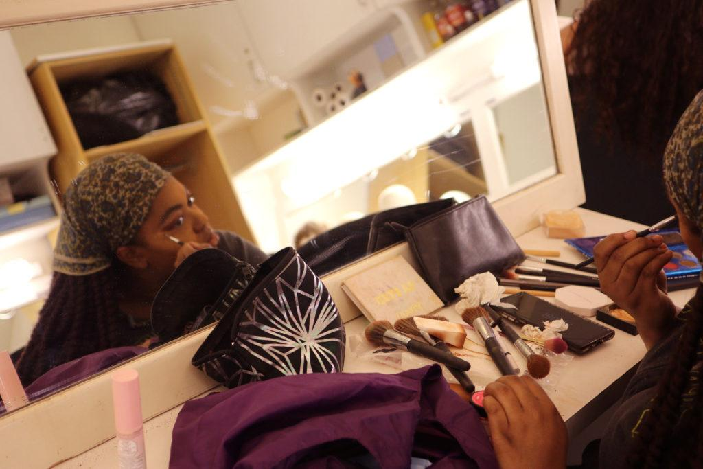 Julia Anderson puts on her makeup for the play, Pericles, in the Little Theatre on Thursday Nov. 1, 2018. (Oscar Rendon/Golden Gate Xpress)