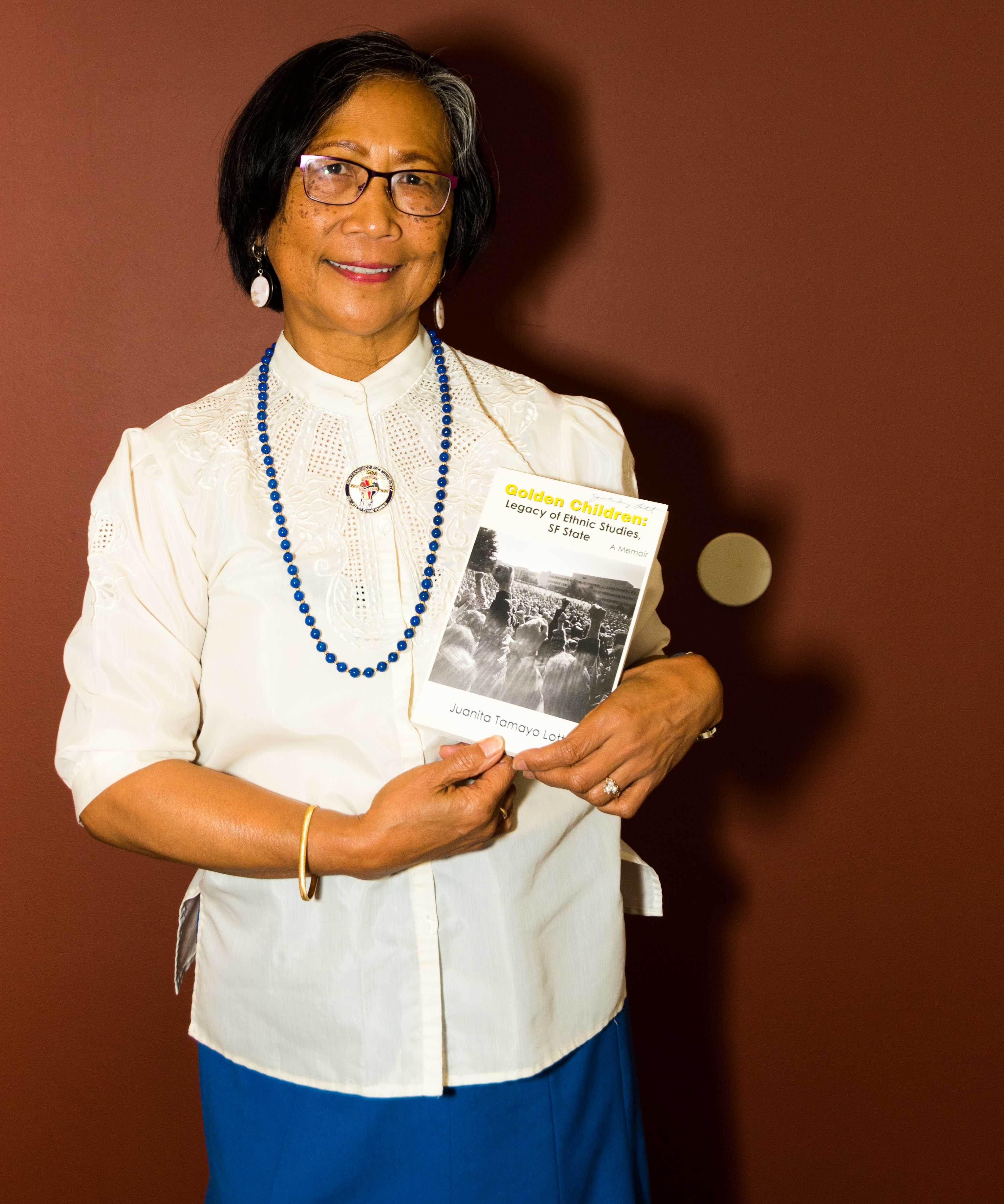 "One of the strikers of the 1968-69 SF State student strike Juanita Tomayo Lott shows her latest book, ""Golden Children: Legacy of Ethnic Studies, SF State,"" at Towers Conference Center for the event to commemorate the 50th Anniversary of the SF State Student Strike at SF State on Saturday, Nov. 10, 2018."