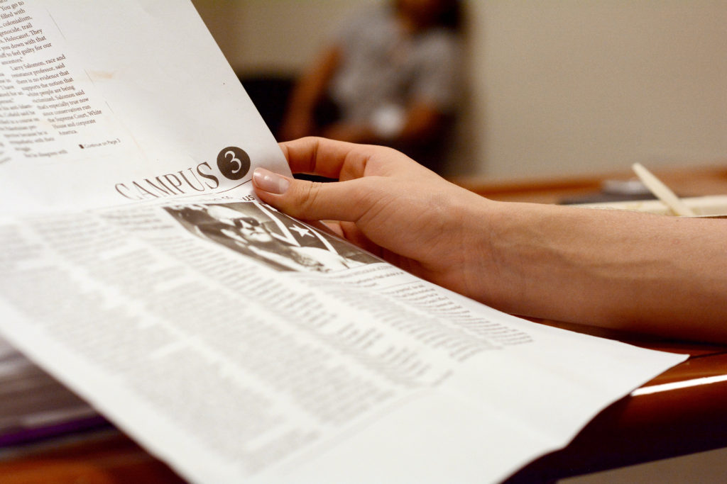 Francisco Lazo, 19, a second-year economics major and Campus Recreation representative, holds a reprinted copy of a Golden Gate Xpress story on the self-proclaimed white nationalist Brian Cofield at a University Affairs meeting, - a board comprised of elected Associated Students officials - at SF State on Monday, Nov. 5, 2018. The UA passed a motion to invite Cofield to a closed-session University Affairs meeting. (Aaron Levy-Wolins/Golden Gate Xpress)