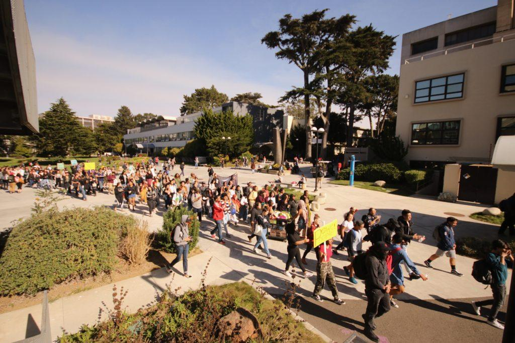 Students and others head toward the Administration Building during a walkout in honor of the '68 strikers at SF State on Thursday November 8, 2018. © (Oscar Rendon/GoldenGateXpress)