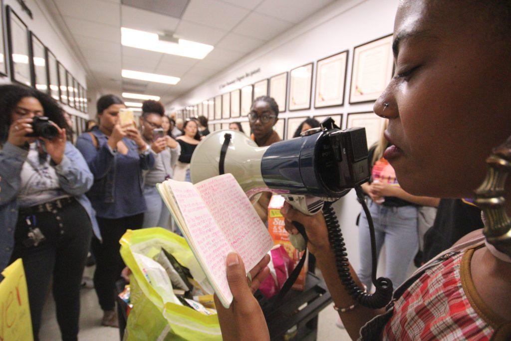 Isis D., 22, senior, Communications Africana Studies major, reads spoken word in the hall of the Administration Building during a walkout in honor of the '68 strikers at SF State on Thursday November 8, 2018. © (Oscar Rendon/GoldenGateXpress)