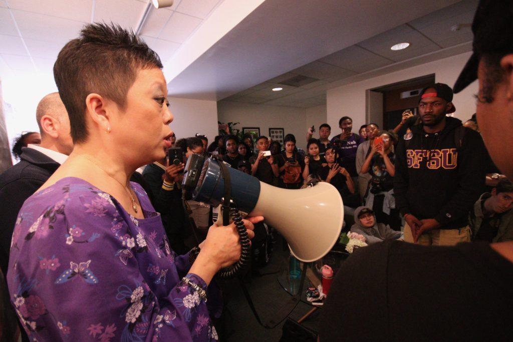 Luoluo Hong, Vice President of Student Affairs & Enrollment Management, has a conversation with students during a walkout in honor of the '68 strikers at SF State on Thursday November 8, 2018. © (Oscar Rendon/GoldenGateXpress)