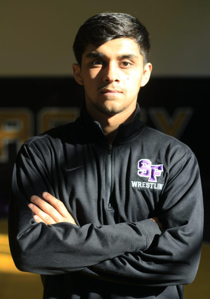 Nathan+Cervantez%2C+who+is+a+member+of+the+SF+State+wrestling+team+and+a+business+major+at+SF+State+gets+ready+for+practice+with+his+teammates+on+Thursday+November+8%2C+2018.+Cervantes+is+ranked+No.+5+in+NCAA+Division+II+and+finished+second+at+NCAA+Division+II+Super+Regionals.+%28LINDSEY+MOORE%2FGolden+Gate+Xpress%29