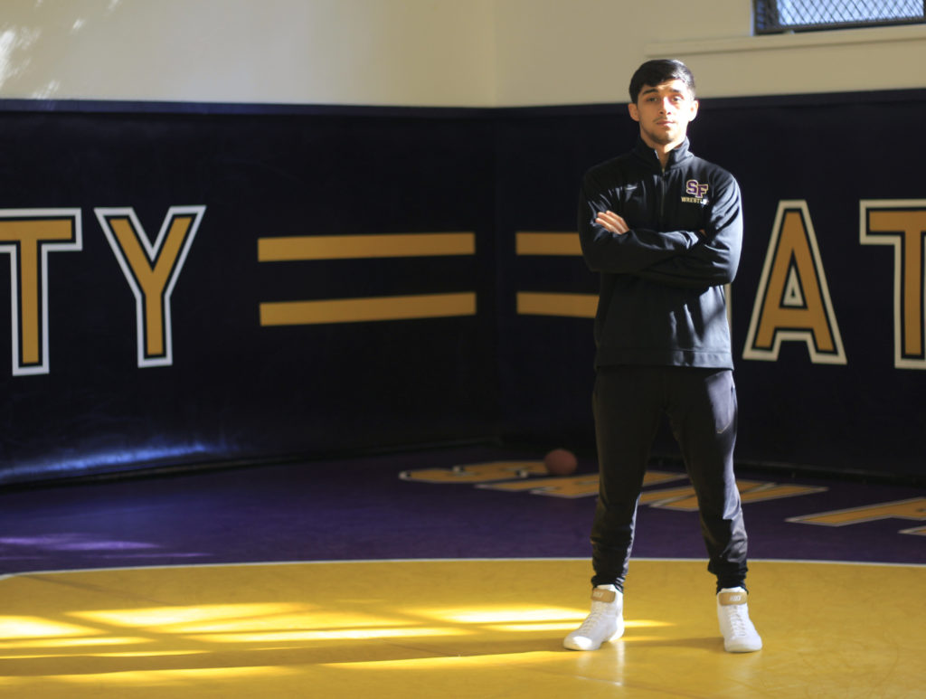 Nathan Cervantez, who is a member of the SF State wrestling team and a business major at SF State gets ready for practice with his teammates on Thursday November 8, 2018. Cervantes is ranked No. 5 in NCAA Division II and finished second at NCAA Division II Super Regionals. (LINDSEY MOORE/Golden Gate Xpress)