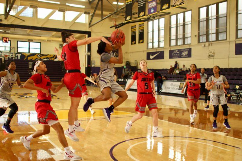 Gator Toni Edwards leaps towards the net with ball in hand at the women's basketball game on Nov. 25, 2018 where SF State beat Academy of Art University 102-92. (Francisca Velasco/Golden Gate Xpress)