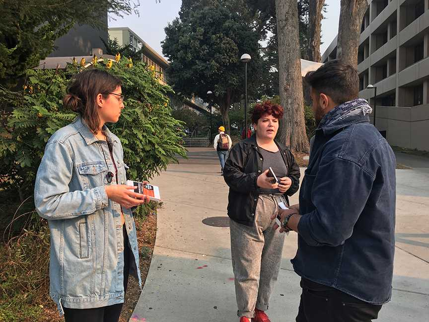 Rudy Rochon, Columbia University graduate and member of Students Supporting Israel (right) speaks with two SF State student members of Jewish Anti-Zionist Network, who declined to provide their names, on SF State campus on Friday, Nov. 9, 2018. (Sylvie Sturm/Golden Gate Xpress)