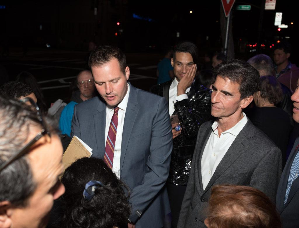 Candidate for San Francisco District 6 Supervisor Matt Haney (center) speaks to local media while California State Assembly member Mark Leno (right) looks on outside of Calle-11, a nightclub in San Francisco on Tuesday, Nov. 6, 2018. (Chris Robledo/Golden Gate Xpress)