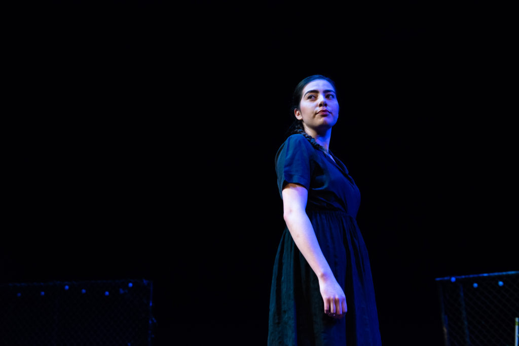 Gabrielle Trejo, 21, is a communication major stands on stage inside the Little Theater for the final dress rehearsal of