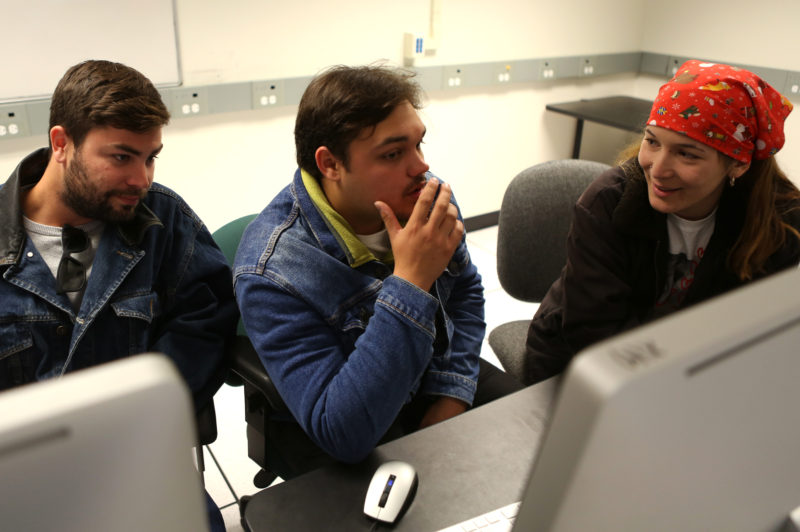 Producer Jeep Tatcher (left), director Jake Naso (center) and producer Maddy Graves (right) sit in one of the Cinema production labs while discussing the process of making their film