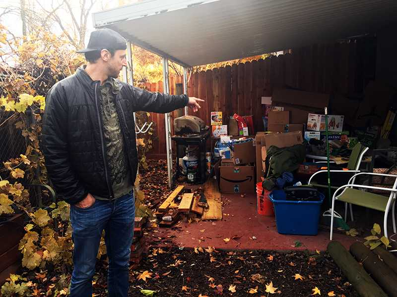 Luigi Balsamo looks at the donations of diapers, clothes, blankets and assorted household goods for Camp Fire victims sent to him in Chico, California on Saturday, December 1. (Sylvie Sturm/Golden Gate Xpress)