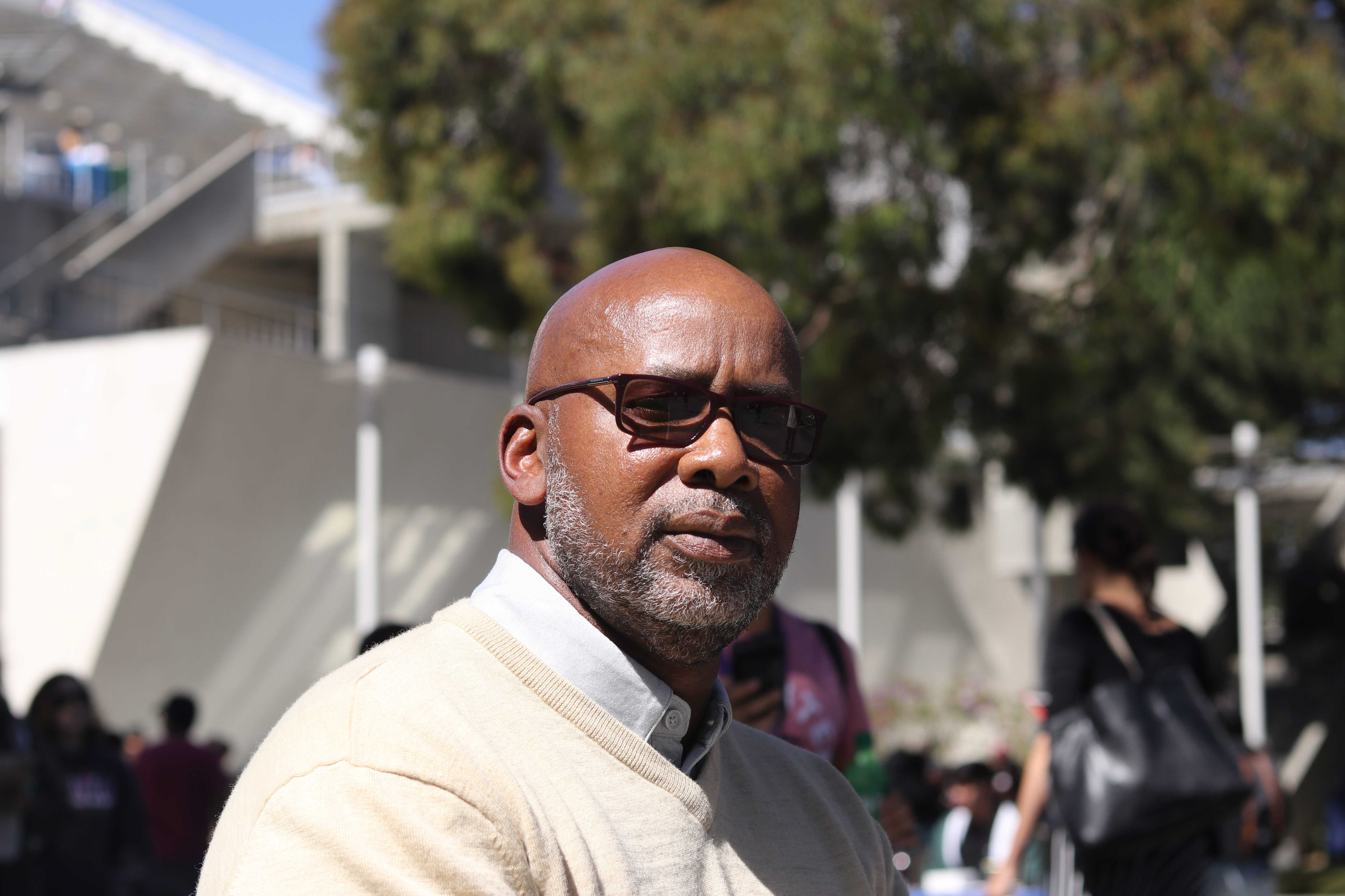 Orlando Harris, Director of Career Services and Leadership Development, has his portrait taken near Malcolm X Plaza at SF State's on Sept. 10, 2018. (Oscar Rendon/Golden Gate Xpress)