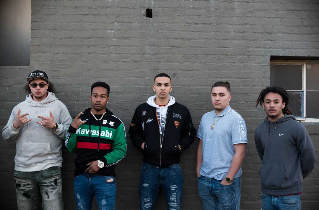 SF State biology major Isaiah Corona (far left), 19, political science major Kenneth Cason (left), 22, psychology major Jacob Shur (center), 19, Isaiah Price (right), 19 and Jordan Braithwaite (far right) form an student collective that collaborates on producing rap music. The group is getting ready to release a mixtape as well as individual musical projects as they balance the demands of school work and their passion for music. (Chris Robledo/Golden Gate Xpress)