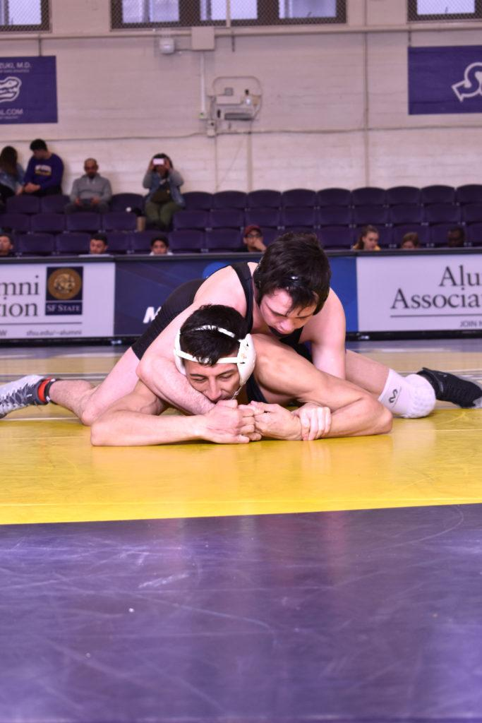 A player from the New Mexico Highlands wrestles with Isiah Alva in the Swamp at SF State in on Friday, Jan. 25.