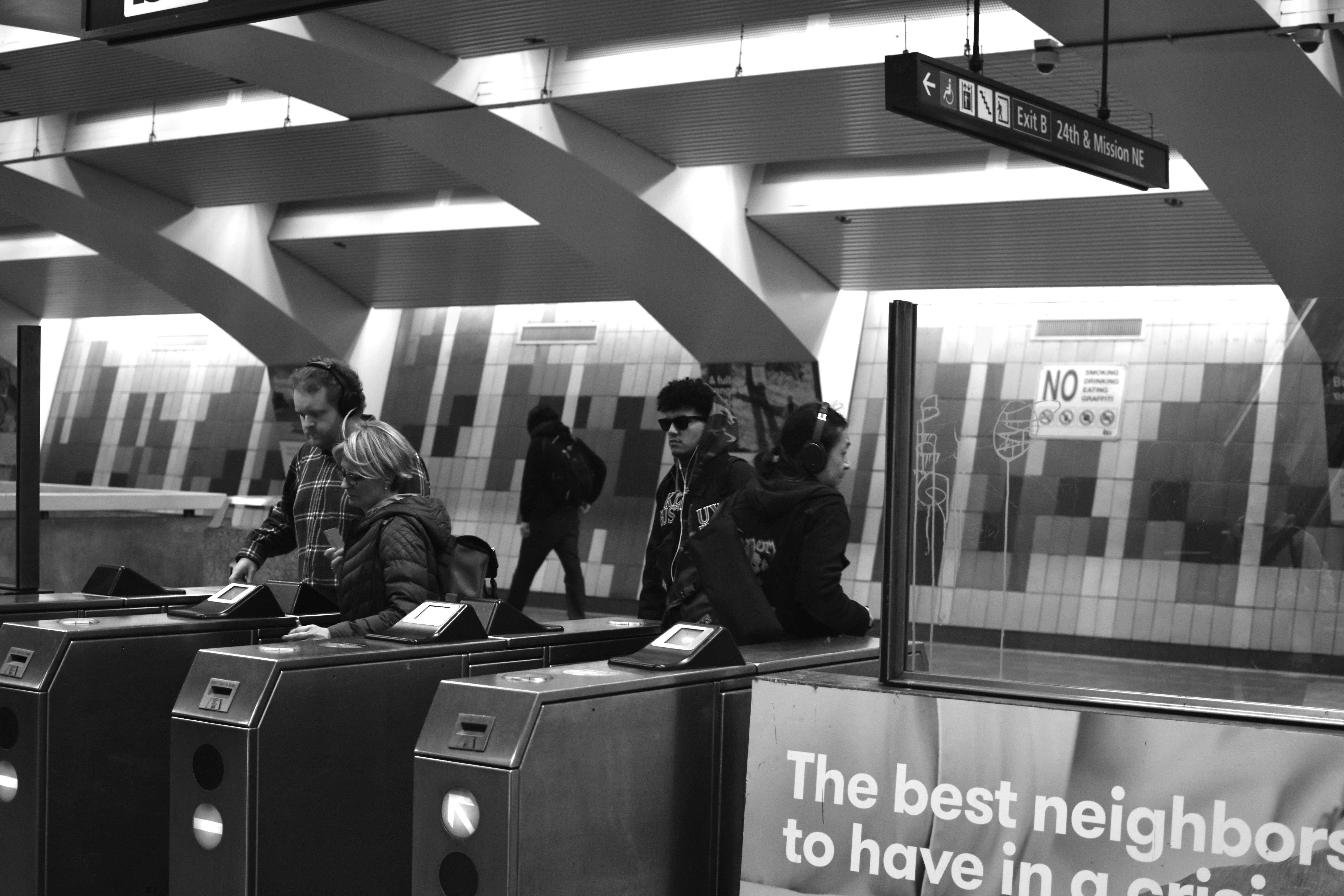 People enter the 24th Mission Street BART station using their Clipper cards on Saturday, Jan. 26 in San Francisco.
