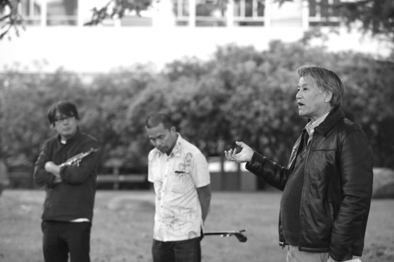 Rev. Michael Yoshii (right), a human rights activist, speaks to a group as Asian American studies professors Francis Wong (left) and Wesley Ueunten (center) listen on during Day of Rememberance, Tuesday, Feb. 19, 2019. (JAMES CHAN/ Golden Gate Xpress)