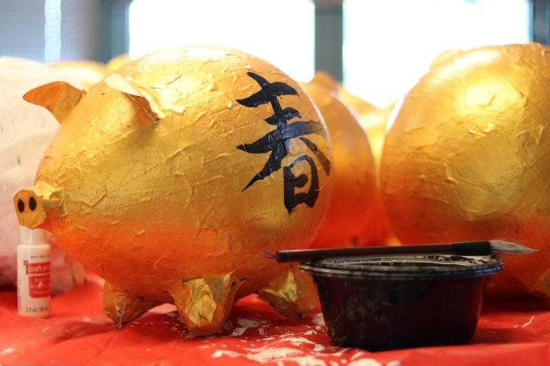 One of the golden papier-mache pigs that's being used as a table center piece for the Chinese New Year Celebration in the humanities building on Feb. 20, 2019.
