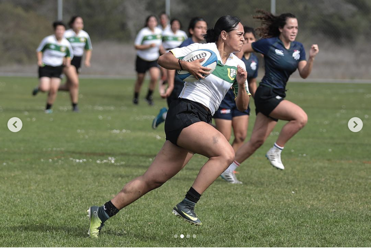 Fia Tautolo, rugby player and SF State student, sprints from defenders in a game on Oct. 29, 2019.(Special to Golden Gate Xpress/Lizeth Lafferty)