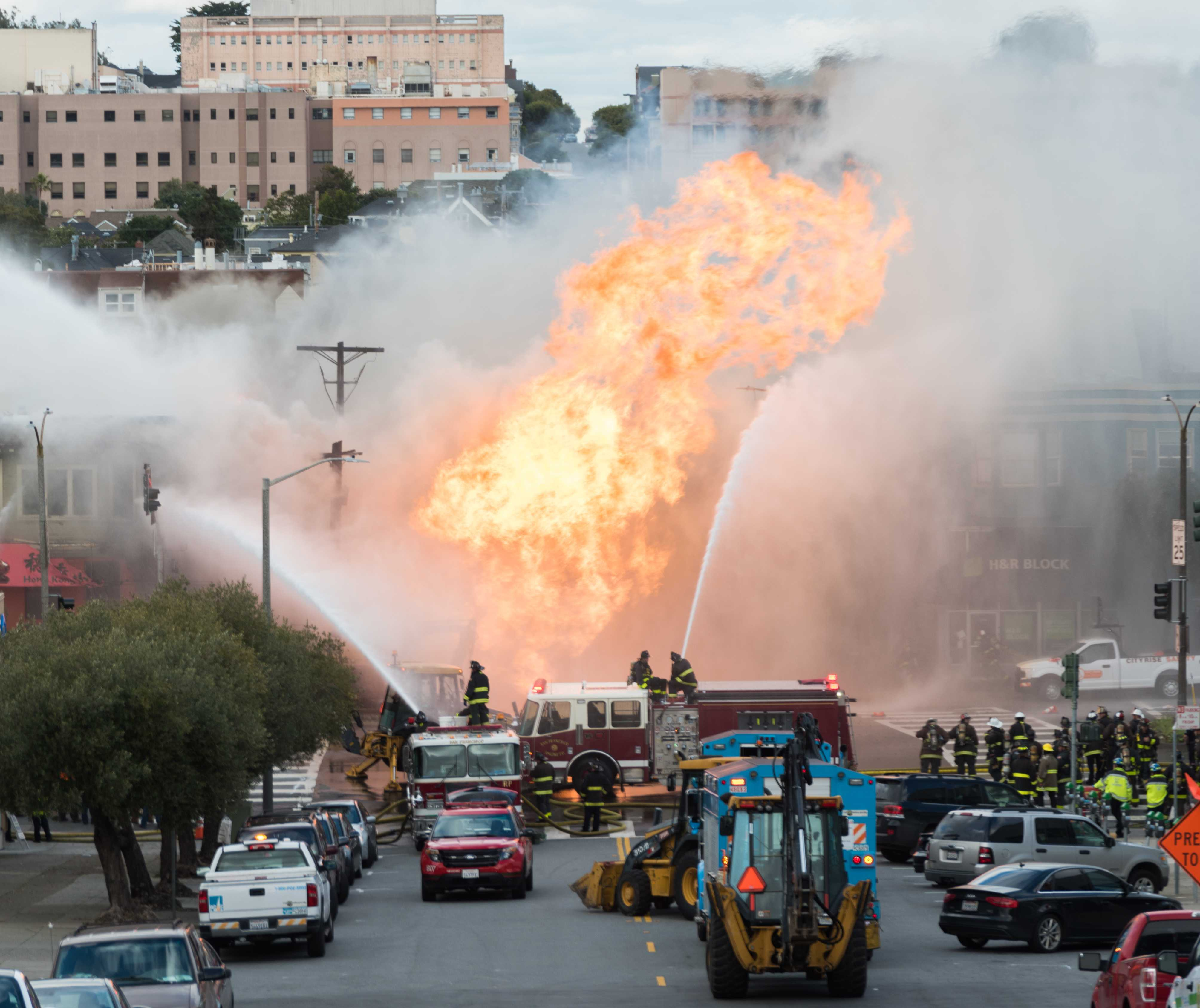 Flames engulf a building near the intersection of Geary Boulevard and Parker Avenue in the Inner Richmond district of San Francisco, Calif., on Wednesday, Feb. 6, 2019.