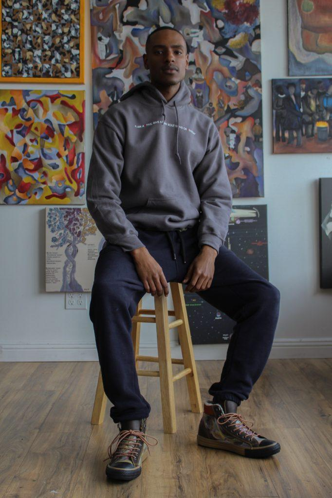 Mike Texada, former SF State student and multidisciplinary artist, poses for a photo in his Oakland studio. (Julian Moncaleano/Golden Gate Xpress)