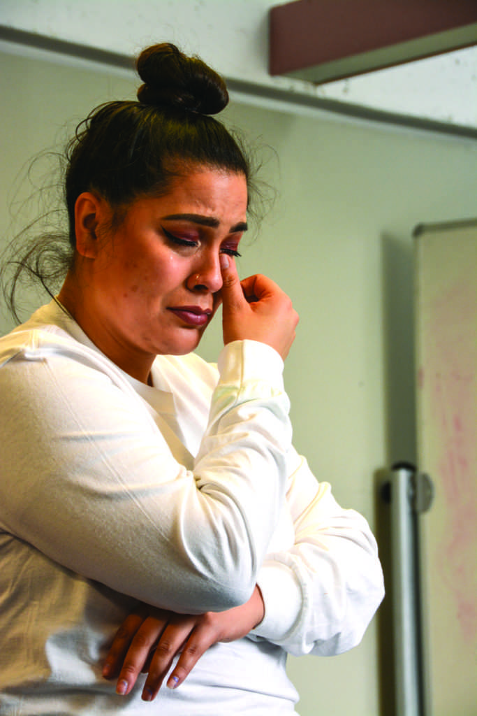 Alumna Michelle Moran cries during a workshop on reconnecting with your body against the pressures of society to fit a certain standard at the eighth annual Women's Center Conferenceon March 9, 2019. (Shaylyn Martos/ Golden Gate Xpress)