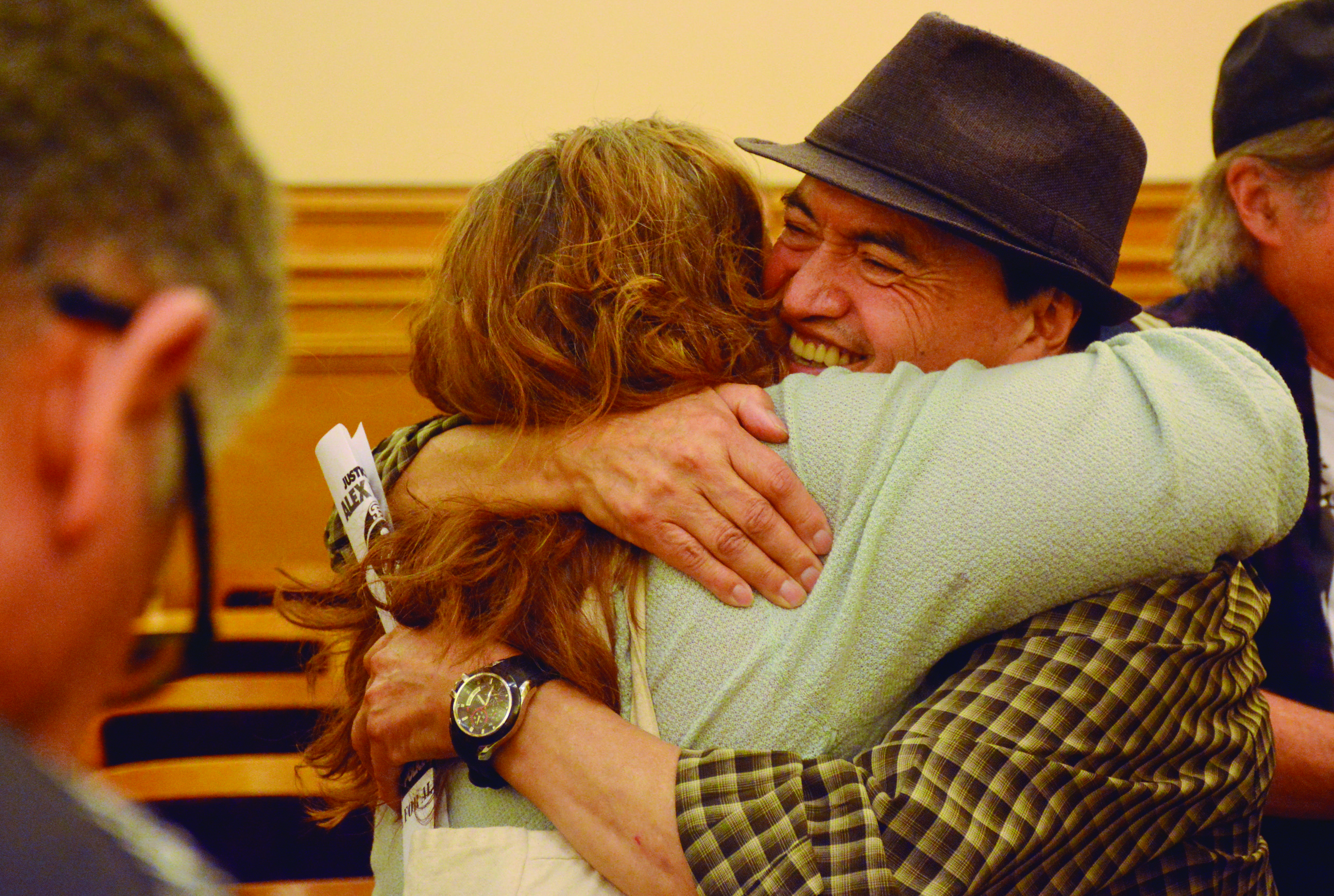 Alex's father, Regugio Nieto, hugs Jennifer Raviv after the decision was made to build a memorial with the proper language to remember Alex Nieto's death in Bernal Heights, where he was shot 59 times by police officers in 2019. Photo by Tristen Rowean.