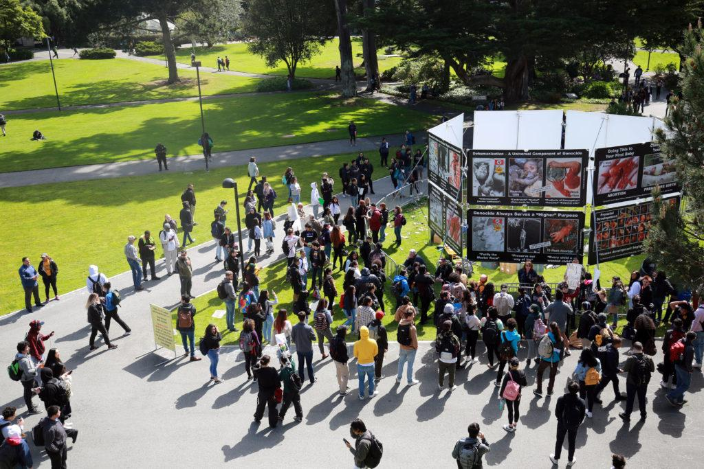 Students gather around the anti-abortion display set up in the quad Apr 15, 2019 (JAMES CHAN/Golden Gate Xpress)