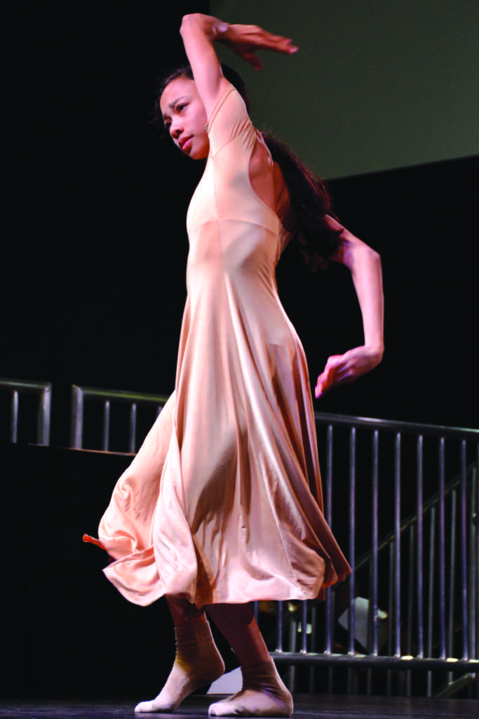 Award-winning ballerina, Mahalaya Tintiangco-Cubales, performs during Moving Mountains: A Celebration of 50 Years of Asian American Studies at SF State. (TRISTEN ROWEAN/Golden Gate Xpress)