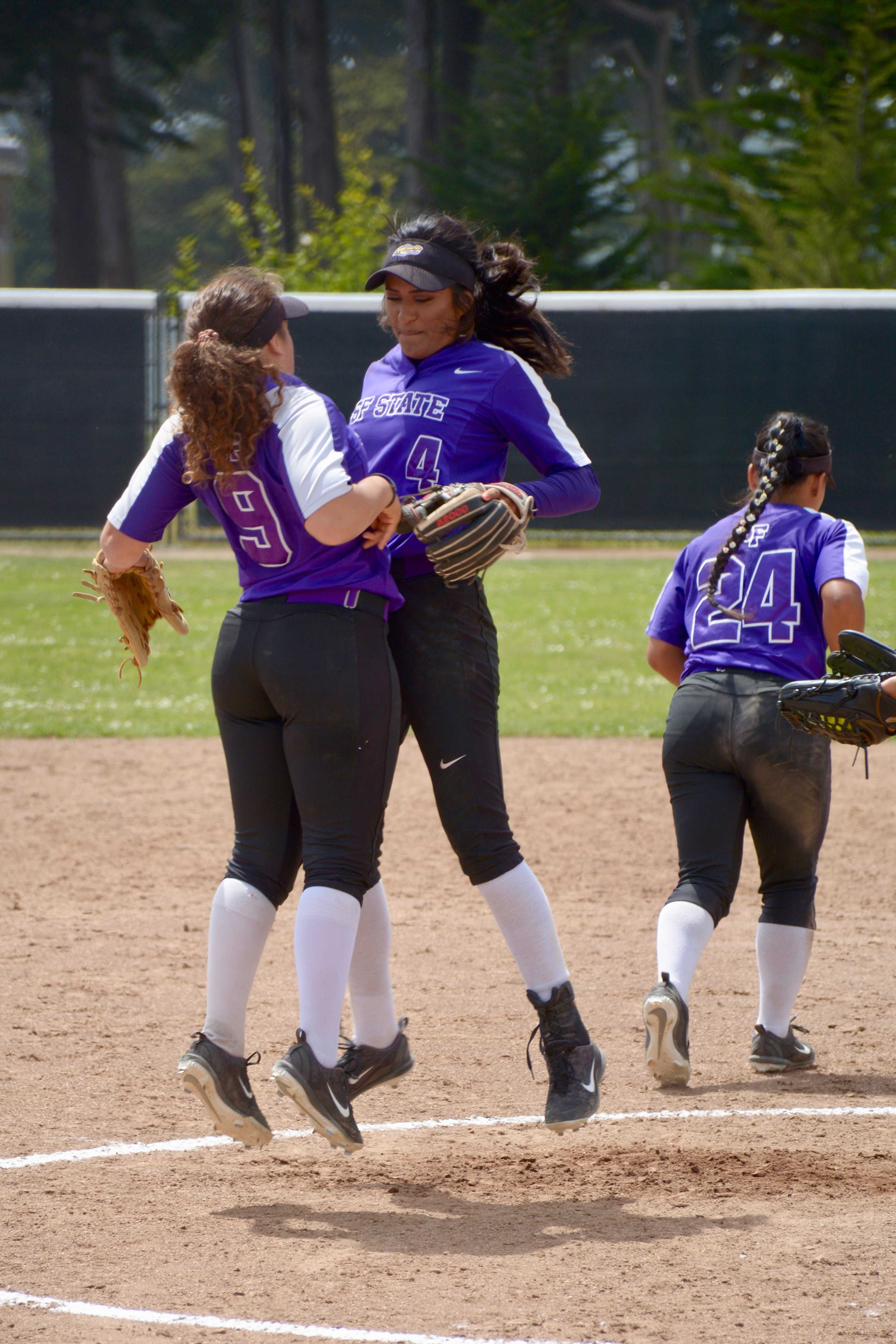 Hayley Nunes chest bumps Michele Castro during the Gators game against the CSU East Bay Pioneer's in a doubleheader for Senior Day on Saturday, April 27th, 2019. Photos by Tristen Rowean.